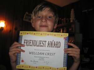 Willy holding an award that says: Friendliest Award